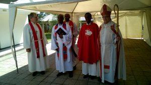 Pastorit Anssi Simojoki, Jonas, Mekonen ja Mohamed Gurhan.